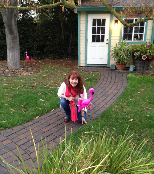 This is a picture of me in front of my studio, with a plastic flamingo.